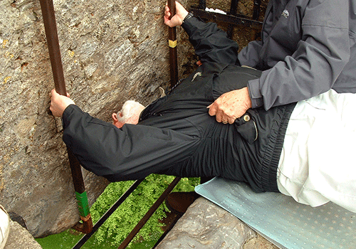 Leaning backwards to kiss the Blarney Stone